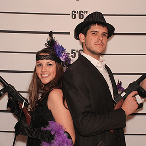 Buffalo Murder Mystery party guests pose for mugshots
